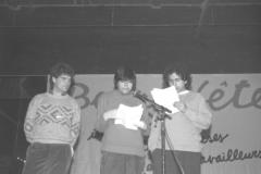 Rassemblement suite à la manifestation du 1er mai 1987. Sur la photo, Pierre Paquette, président du Conseil central de Montréal de la CSN, et Carmen Gloria Quintana. / Photographie de André Querry